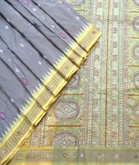 Aurometalsaurus and yellow handwoven fancy silk saree